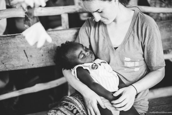 KaitlynBouchillon.com holding a child in Haiti